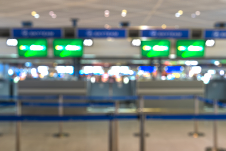 ticketing: Check-in ticketing counter at international airport - blurred Editorial