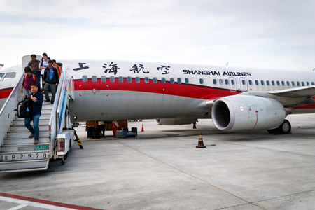 Shanghai, China - circa September 2016: Passenger boarding off a Shanghai Airlines aircraft landed in Shanghai Pudong Airport, China. Shanghai Airlines is a major regional airline in Asia with its headquarters in Shanghai.