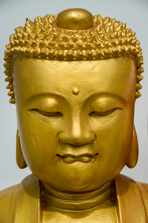 budda: Portrait of a golden Budda statue head