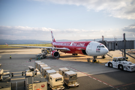 Osaka, Japan - October 2016: Air Asia X aircraft landed at Kansai International Aiport, Osaka, Japan. Air Asia X is a long-haul, budget airline based in Malaysia; and a sister company of AirAsia. Editorial