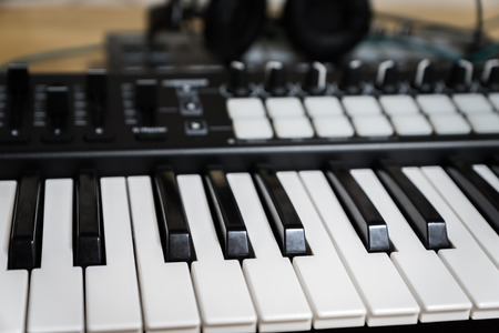 deceleration: MIDI keyboard synthesizer piano keys closeup for electronic music production  recording