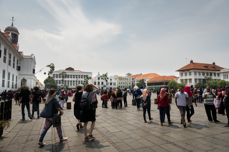 Indonesia - October 2017: Crowd of people at Jakarta Old Town square, a popular tourist destination, in Jakarta. Editorial
