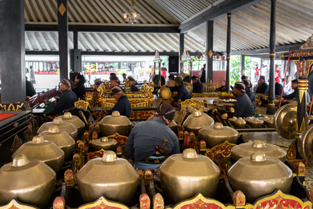 Yogyakarta, Indonesia - October 2017: Musicians performing Gamelan music and Wayang, shadow puppet show, at King's palace. Gamelan is a traditional music in Java and Bali in Indonesia.