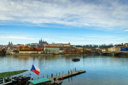 Prague, Czech Republic -December 2017: Beautiful winter view of Vltava river, boat, castle, old town in Prague, Czech Republic. Taken in the city center of Prague.