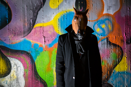 strange man wearing a scary horse mask in night Stock fotó