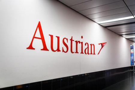 Vienna, Austria - December 2017: Austrian airlines logo at Vienna Schwechat Airtport Terminal 1. Austrian Airlines is the flag carrier of Austria. 新闻类图片