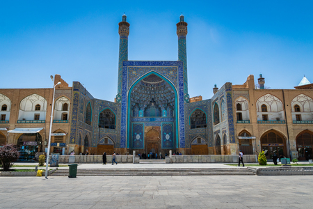 Isfahan, Iran - April 2018: Historic Imam Mosque at Naghsh-e Jahan Square, Isfahan, Iran. Construction began in 1611 and is one of the masterpieces of Persian architecture in the Islamic era