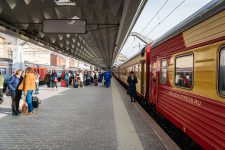Saint Petersburg, Russia - May 2019: Grand Express night train at the platform in Saint Petersburg Moscau train station. Grand Express is a luxury night train that travels Moscow - St. Petesburg.