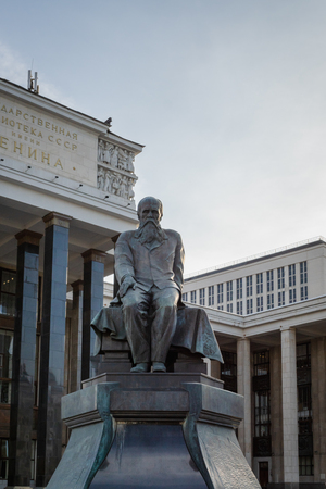 Moscow, Russia - April 2019: Monument to Fyodor Dostoevsky, an acclaimed Russian writer, in front of the Russian State Library. 에디토리얼