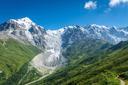 Svaneti landscape with glacier and snow-capped mountain in the back near Mestia village in Svaneti region, Georgia. Stok Fotoğraf