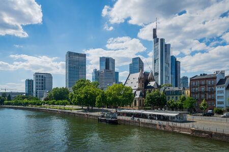 Frankfurt, Germany - July 2019:  city skyline and the river of Frankfurt am Main in summer