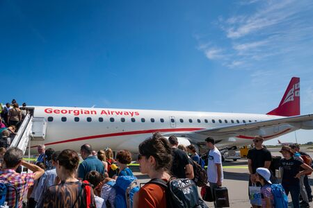 Berlin, Germany - July 2019: Georgian Airways Embraer aircraft and passengers boarding. Georgian Airways, formerly Airzena, is the privately owned flag carrier of Georgia