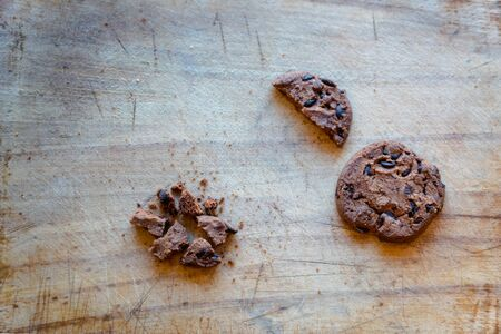 Broken chocolate chip cookies. Cookies broken in pieces with crumbs - concept image for internet privacy and data security