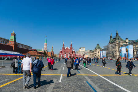 Moscow - May 2019: Red Square view and visitors on spring day in Moscow, Russia. Red Square and Kremlin are the top tourist attraction of Moscow.