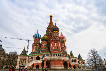 Moscow, Russia - April 2018: St Basil's Cathedral on Red Square in Moscow, Russia. St Basil's temple is one of top tourist attractions of Moscow. Ancient architecture of Moscow.