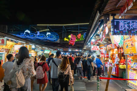 Hualien, Taiwan - March 2019: Hualien night market and visitors walking in Hualien City, Taiwan. This market is popular among locals and tourists. Editorial