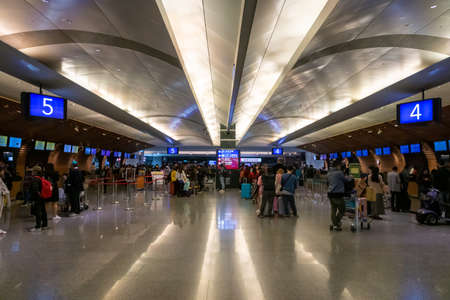 Taipei, Taiwan - February 2019: Taipei Taoyuan Airport architecture and passengers inside. Taipei Taoyuan airport is one of the busiest airports in the world.