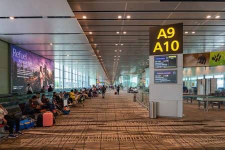 Singapore - January 2019: Singapore Changi Airport architecture and passengers. Singapore. Changi Airport is one of the largest airports in Asia. Editorial