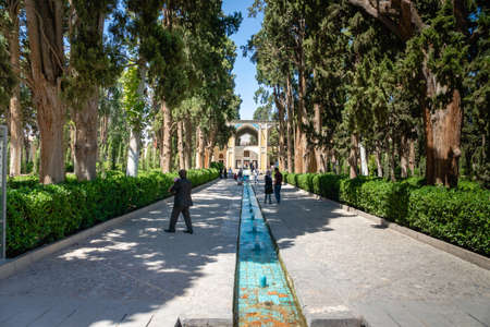 Kashan, Iran - June 2018: Fin Garden in Kashan, Iran  and visitors - Fin Garden is one of the most famous royal gardens in Iran.