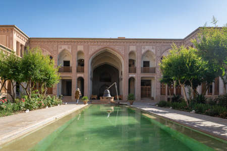 Kashan, Iran - June 2018: Ameri House architecture and garden in Kashan, Iran. The Āmeri House is a large historic house and a popular tourist destination.