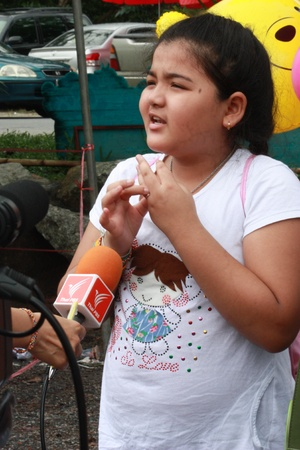 interviewed: Songkla, Thailand - january 14, 2012 - Unidentified child are being ThaiPBS journalist interviewed in children.