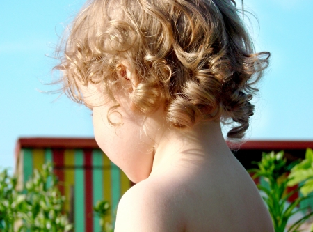 curly headed: Close up of little baby