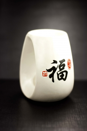 White oil burner in oriental style on a black background photo