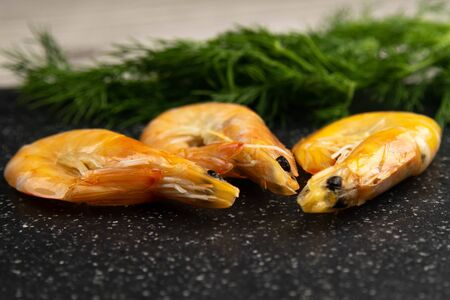 Delicious cooked shrimps on grey marble table krop in the back. Nice background Banque d'images
