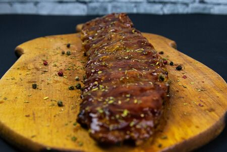 Barbecue Pork Spare Ribs as top view on an old cutting board top views