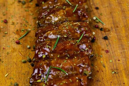 Barbecue Pork Spare Ribs close-up as top view on an old cutting board top views