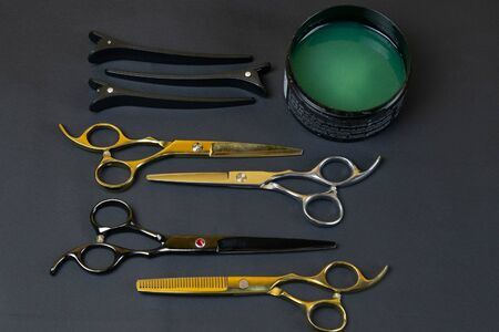 Collection of professional hair dresser tools arranged on dark background. Top views Stock fotó