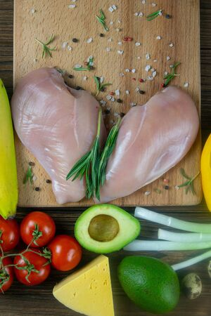 Fresh raw chicken fillet and vegetables prepared for cooking. Top views with clear space. Stockfoto