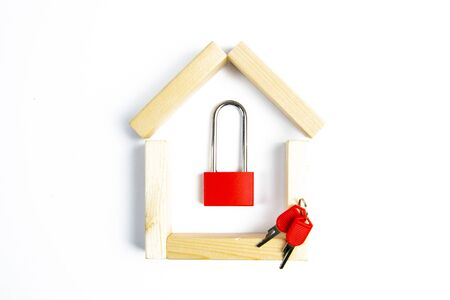 Home security. Smart house. Online authorization code. Wooden house with closed red padlock on plank inside, copy space.