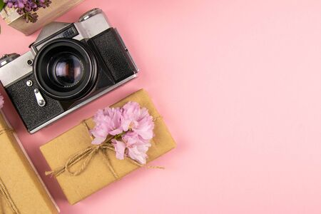 Camera, gift and a beautiful purple lilac. Month - May, June and July. Top views with clear space.