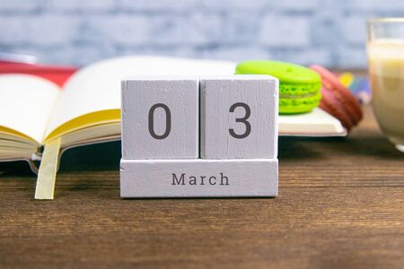 March 3 on the wooden calendar.The third day of the spring month, a calendar for the workplace. Spring.