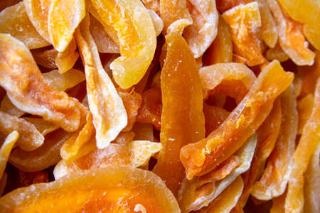 Texture of dried candied melon slices. Top views, close-up