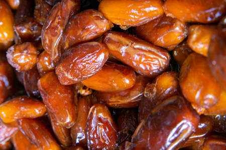 Dried date fruits background. Top views, close-up