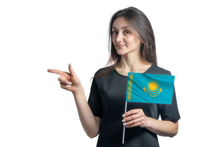 Happy young white woman holding flag Kazakhstan and points to the left isolated on a white background.