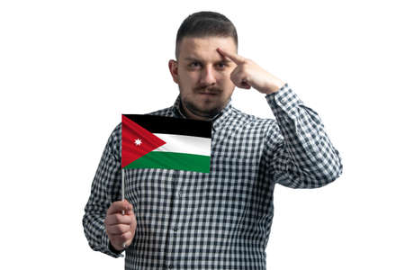 White guy holding a flag of Jordan and a finger touches the temple on the head isolated on a white background.