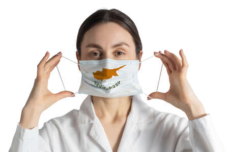 Respirator with flag of Cyprus Doctor puts on medical face mask isolated on white background. Stock Photo