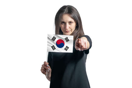 Happy young white woman holding flag of South Korea and points forward in front of him isolated on a white background.