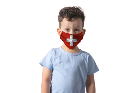 Respirator with flag of Switzerland. White boy puts on medical face mask isolated on white background.