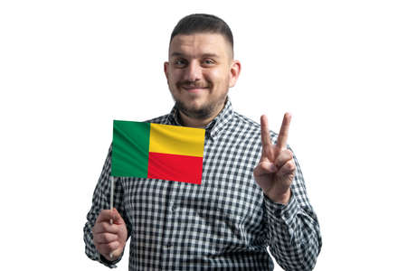 White guy holding a flag of Benin and shows two fingers isolated on a white background. 版權商用圖片