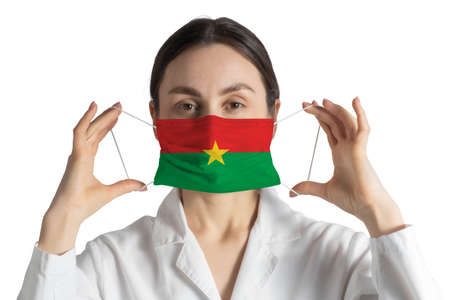 Respirator with flag of Burkina Faso Doctor puts on medical face mask isolated on white background.