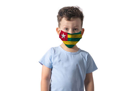 Respirator with flag of Togo. White boy puts on medical face mask isolated on white background.