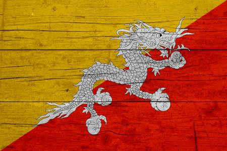 Flag of Butane. Wooden texture of the flag of Butane.