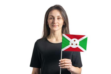Happy young white girl holding Burundi flag isolated on a white background.