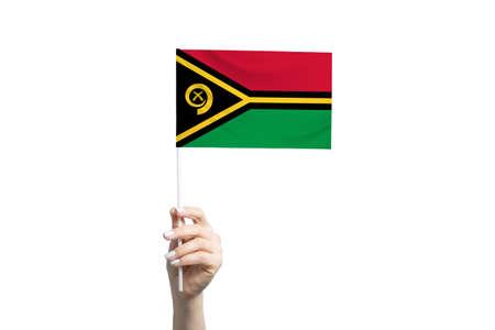 Beautiful female hand holding Vanuatu flag, isolated on white background. 免版税图像