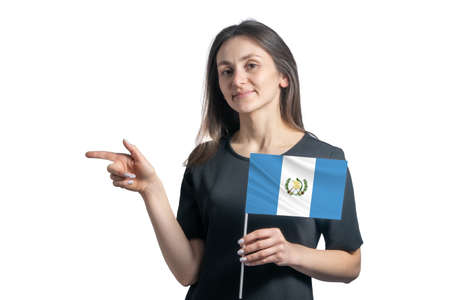 Happy young white woman holding flag Guatemala and points to the left isolated on a white background.