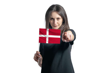 Happy young white woman holding flag of Denmark and points forward in front of him isolated on a white background.